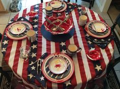 Fourth of July setting for inside or out on my porch.  Red, white & blue work all summer (minus Stars & Stripe linens from Kohls) in sealife tableware.  Crab & lobster dishes were from Kohls some years back - service for six plus lots of great serve ware not shown here.  Pewter crab & blowfish with clear bowls new from PB.  Anchor plates/mugs this year from Tuesday Morning. See more on My Summer Porch, Nautical Home board.