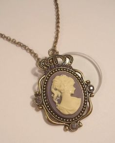 Magnifying Glass Antiqued Bronze Cameo Pendant by JENSTARDESIGNS, $26.99