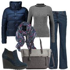 Una proposta casual e semplice, perfetta per lo shopping natalizio last minute. I jeans blu scuro, in modello bootcut a vita alta, sono abbinati al maglione grigio a collo alto. Il caldo piumino blu dal taglio corto è arricchito dalla sciarpa fantasia, che riprende le tonalità generali dell'outfit. Gli stivaletti blu, comodi nonostante la zeppa e la borsa in feltro, sui toni del grigio, completano il look.