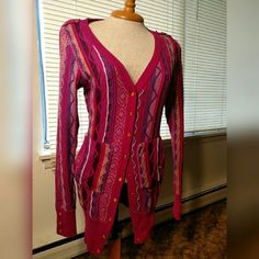 WKEND SALE Coogi Pink Knit Sweater Gold snaps, two pockets, great detailed work. Has belt straps, but is not sold (even new) with a belt. Mainly pink with other colors to accent.   This is the casual Coogi line made in China, not Coogi's Australian line.   Has some mild pilling. COOGI Sweaters