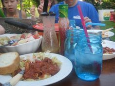 Simple meal on a simple table. Summer outside dining. Mom's Simple Spaghetti