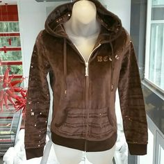 LAST DAY BCBG brown hoodie sweatshirt Grab it before it is removed from my closet. FINAL PRICE, Item will be discontinued  Brand with tags BCBG chocolate brown hooded zip up sweatshirt. Sleeves, front pockets and hood has rows of brown sequins. The back has sequin detail heart and BCBG logos, BCBG logo in sequins on hood and front corner of sweatshirt. Covered in deatils, this sweatshirt is easy to grab and go!  80%cotton 20%polyester BCBG Tops Sweatshirts & Hoodies