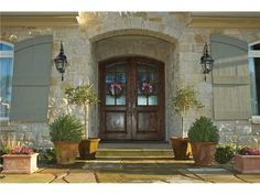 Hill Country home, LOVE LOVE LOVE this style, stone , beautiful shutters, brow arches