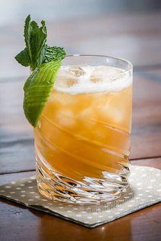 The Ancient Mariner: Dark Jamaican Rum, Demerara Rum, Lime Juice, Grapefruit Juice, Simple Syrup (1:1 Demerara Syrup) (recipe), Allspice Dram Liqueur Lime Wedge, Mint Sprig.