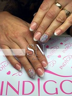 Swarovski Nails Stylization By Monika Kaczmarek Indigo Young Team :)  Find more Inspiration at www.indigo-nails.com #french #mani #indigo #nails #swarovski #blingbling
