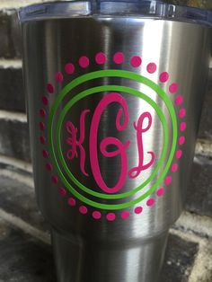 If its not moving, monogram it! We Southerners know everything is better with a monogram.  This decal is printed on the popular indoor/outdoor adhesive vinyl. As this is a high quality vinyl, it will stand the test of time on your vehicle, Yeti, tablet, binder, laptop, tumbler, etc. The sky is the limit!  Other color and style options are available, so please message me and we can get started on your custom design!  Your order includes ONE Indoor/ Outdoor Vinyl Monogram in pink and green…