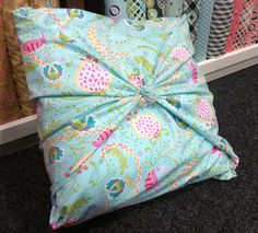 A simple step by step guide on how to make a no sew cushion cover. All you need is one metre of fabric and a cushion.