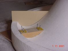 Shaping the 'mouth-roll' with a curved sandpaper block.
