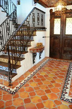 This Spanish style home features handmade Saltillo terracotta floor tile and painted Talavera Mexican tiles. The flooring is a 2-tile Riviera pattern by Rustico Tile and Stone. Learn more at Rusticotile.com and check out their worldwide shipping options and wholesale prices. #homedecor
