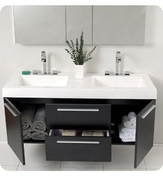 Double sink, floating cabinet.