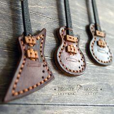 Готовы новые три гитары-подвесы с кармашком на тыльной стороне для медиатора. Натуральная кожа, ручной шов. #BronzeHorse, #подарок, #медиатор, #гитара, #handmade, #handcraft, #ручнаяработа, #leather, #кожа , #натуральнаякожа, #изделияизкожи, #изкожи, #leathercraft, #leatherwork, #браслет, #бумажник, #кошелек, #кардхолдер, #bracelet , #wallet , #leathercuff , 4 #cardholder, #браслетдлячасов, #подвес, #брелок