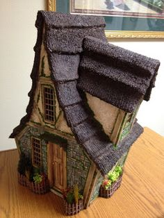 Miniature cottage by greggsminiatureimaginations from Denver, CO. The thatched roof is made from a towel cut, applied, and ModPodged!