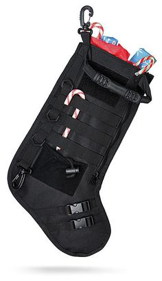 """The Tactical Christmas Stocking from ThinkGeek is for those that need  everything """"tactical"""".It's got integrated MOLLE straps on the outsid..."""