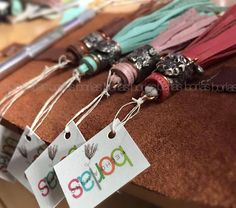 Borlas  Borlas is our exclusive line of tassels made with genuine leather and hand worked cooper ornaments. Each tassel is a unique one of a kind collection item, individually marked.