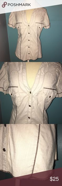 Rock & Republic short sleeve blouse western top Rock & Republic short sleeve top size large. This western/cowgirl look comes in a soft tan/ecru/cream color with two different brown threads for design. Five buttons down the middle with two buttoned pockets. Measurements laying flat down armpit to armpit is 21, armpit to hem is 13 1/2, shoulder to hem is 25. Super cute to wear with your favorite cowgirl boots. This listing is for the top only. Bundle this top with my Rock & Republic jeans for…