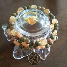Green unakite and amber Buddha bracelet and matching ring.Read below for more information in the stones in this product.