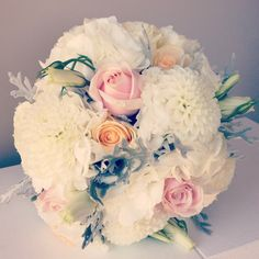 Vintage wedding bouquet of roses, lisianthus, hydrangeas and dahlias. needs more color but like flower choices