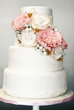 My cake design - white, textured, with pink, peach, and pale blue flowers, gold accents. The flowers on the cake are inspired by my dress, and flowers on the invite should coordinate as well.  #pinBellaFigura
