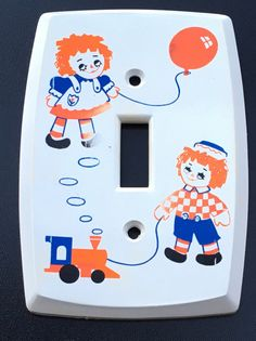 A personal favorite from my Etsy shop https://www.etsy.com/ca/listing/480598567/raggedy-ann-raggedy-andy-light-switch