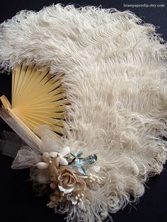 Vintage Ostrich Feather Fan...not just for wedding but for fancy fanning in general...like a ball perhaps.