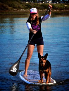 A girl and her dog, so cool. I don't think I could get my 2 dogs to stay on. I want a SUP. So fun.