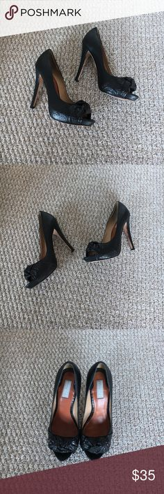 Badgley Mischka Leather Heels 7.5 Badgley Mischka Black Leather Heels 7.5. Very sexy looking and very comfortable. In good condition, only a tiny white dot on the back and some scuffing inside of the left heel shown in pictures. Any questions, please ask :) I am open to offers Badgley Mischka Shoes Heels