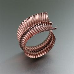 If you're not the type to settle for the same cookie-cutter bracelet as the next gal, then you will want something like this cuff. It's as dramatic and distinctive as you are. Elegant and contemporary in design, this handmade #Fold-Formed #Corrugated Anticlastic #Copper Bangle is exquisite from every angle. The corrugation adds a distinctive visual texture that compliments the sleek #anticlastic design.
