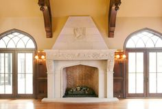 Fireplace serves as centerpiece for spacious living room From a limestone website