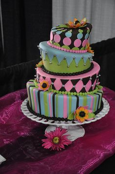 Colorful Topsy Turvy Cake by Designer Cakes By April, via Flickr
