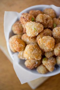 parmesan cauliflower poppers made 10/13 These are good. I baked mine at 400* for 25 min instead of frying them. Next time I'll use more salt as well, but I like them for something a little different.