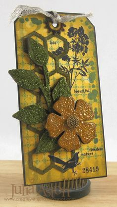 Create With Me: I made this tag for the Compendium of Curiosities Challenge #2 - Distress Glitter Technique - which I used on the Art Parts green stem on my tag.  I used Distress Crackle paint/Rock Candy on the Art Parts Flower - stamps from Wendy Vecchi Studio 490, Tim Holtz Stencils, Remnant Rubs and dies.