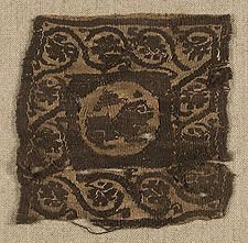 Coptic Tunic Insertion  Egypt  5th to 6th century  Linen and wool. 10.7 cm x 11 cm.  Slit tapestry