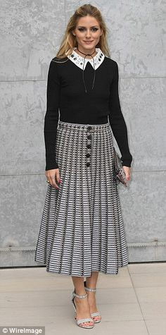 That's how its done: Olivia Palermo (L) looked her usual classy self in a monochrome midi skirt and collared blouse, while Italian actress Ilaria Spada (R) sported a chic grey two-piece suit