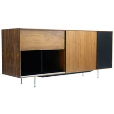 George Nelson for Herman Miller 'Thin Edge' TV / HIFI Cabinet model 5718 | From a unique collection of antique and modern sideboards at https://www.1stdibs.com/furniture/storage-case-pieces/sideboards/
