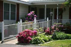 mobile home porch designs with ramp | Wheelchair ramp porch and idea of landscaping around it