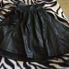 """""""Leather"""" skirt Super cute black skirt. Folded in half in the picture . Never worn, no tags Skirts Circle & Skater"""