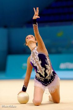 Natalia Azevedo ( Brazil ) 35th in AA qualification I love her leotard!
