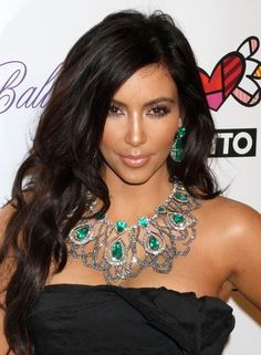 I hate hair extensions but Kim Kardashian always makes her hair look beautiful. Lorraine Schwartz emerald jewellery.
