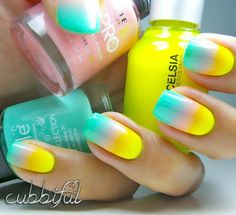 Paint your nails in bright summer inspired colors of yellow, white and sea green.