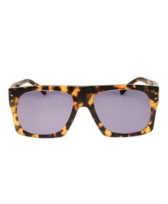 Squared acetate tortoiseshell sunglasses with dark navy lenses by Illesteva. Metal temple accents.