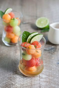 Bourbon and Honey Melon Balls | BourbonandHoney.com -- Boozy, frosty and super refreshing these Bourbon and Honey Melon Balls with fresh mint and lime are the perfect summer happy hour snack.