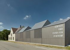 German studio Von M has created a slatted timber extension with a fragmented roofline to house a kindergarten in the German city of Ludwigsburg