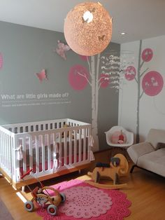 Beautiful baby girl room.  And it has my white Eames rocker.