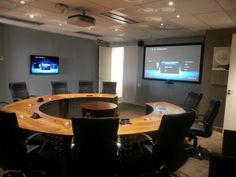 Boardroom installation with Sony WUXGA Projector, Crestron Control System, PTN Signal Scaling, Extron Microphone Processing, Grandview Permanent Frame Screen, PTN Connection Panels, Samsung LED Displays and Huwei Video Conference System