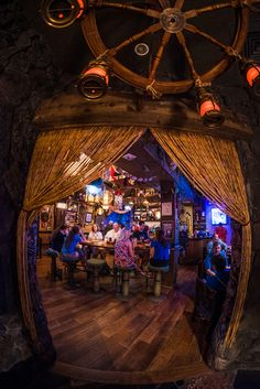 Trader Sam's Grog Grotto is a bar & lounge at Walt Disney World's Polynesian Village Resort. This review features photos from the new tiki bar, my thou