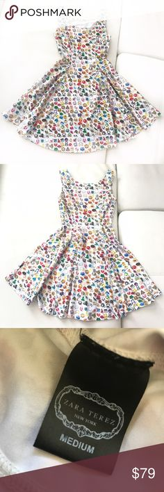 """ZARA Terez white and multicolor emoji dress This adorable emoji dress is perfect for your trendy posh mini! Can be worn by itself or paired with leggings and a light jacket. The material is fitted without being tight. Super comfortable designer dress! In excellent used condition.  😁Pit to pit 11"""" 😁Shoulder 10"""" 😁Waist 18"""" 😁Length 26"""" Zara Terez Dresses Casual"""