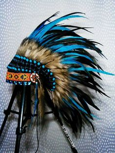Native American Warbonnet Small handmade Indian headdress with about 30 sets of real feathers and with beaded decorative headband. Crafted by