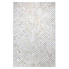 Bring a luxe touch to your foyer, living room, or master suite with this handsomely handcrafted cowhide rug, showcasing a tile-inspired motif in cream.