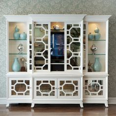 The mirrored fretwork sliding doors discreetly slide close when the television is not being watched