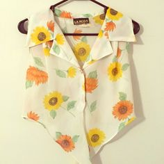 Vintage Floral Top This sheer Vintage tank top is bright and floral yet classy. It buttons up and ties at the bottom. Great with jeans or shorts this shirt has enough pizazz to fill your day with confidence! Vintage Tops Crop Tops